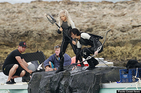 Jennifer Lawrence springs to action while filming scenes for 'The Hunger Games Catching Fire' with co-star Lynn Cohen in Hawaii